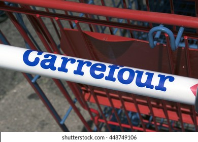 Paris, France-June 20, 2016: letters Carrefour on a shopping cart in Paris