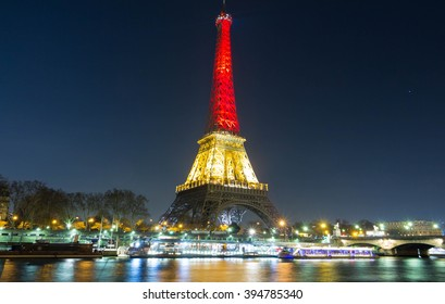 Paris; France-March 22, 2016 : The Eiffel tower lit up with the colors of National Belgian flag to honor to victims of today  terrorist's attack in Brussels.