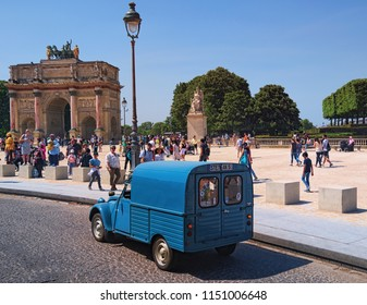 Paris, France-MAY 06, 2018: Ancient blue van - iconic Citroen 2CV Fourgonnette, back view. Arc de Triomphe du Carrousel at the background at sunny day.