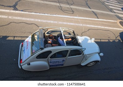 Paris, France-MAY 06, 2018: Iconic Citroen 2CV for rent. Vintage french car with driver is a very popular way for tourists to explore the districts of Paris. Travel and tourism concept.