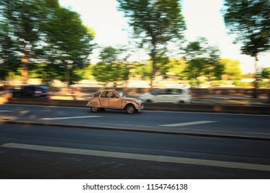 Paris, France-MAY 06, 2018: Vintage Citroen 2cv rides fast along the street of the Paris.