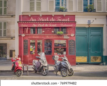 PARIS, FRANCE-MAY 5, 2016: A typical Parisian bistro with scooters parked in front of him. Bistro is a small french restaurant.
