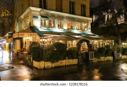 Paris, France-November 10 , 2018: The cafe Louis Philippe situated in a busy corner of the Marais, just at the end of Pont Louis Philippe, is what is possibly the most adorable cafe in all of Paris.