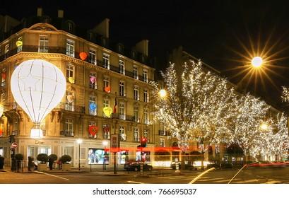 Paris, France-November 26, 2017 : The Christmas decorations on fashion boutique Dior located famous Montaigne avenue in Paris, France.