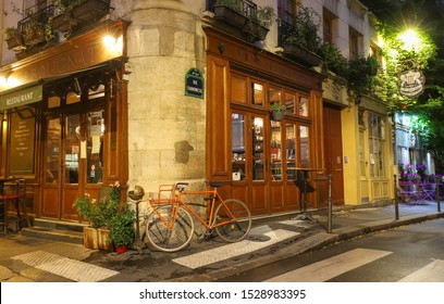 Paris, France-October 08, 2019: the traditional French cafe Au Bougnat at night . It located near Notre Dame cathedral, on the isle de la Cite, in the 4th district of Paris.