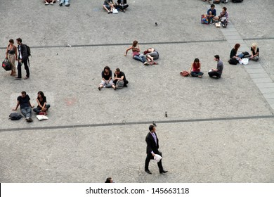 PARIS, FRANCE-OCTOBER, 10:   The 'Place Georges Pompidou' or 'Place Beaubourg', is very popular. The large crowds are animated by mimes, street portraitists etc on October 10, 2012 in Paris.