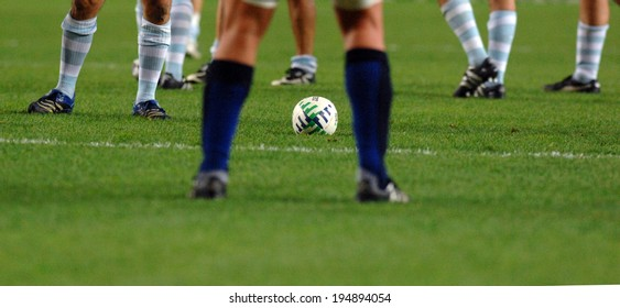 PARIS, FRANCE-OCTOBER 20, 2007: french and argentinian players's legs close by the ball during the semi-final Argentina vs France, of the Rugby World Cup, France 2007, in Paris.