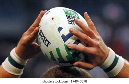 PARIS, FRANCE-OCTOBER 21, 2007:  rugby player's hands holding the official rugby ball during the final England vs South Africa, of the Rugby World Cup, France 2007, in Paris