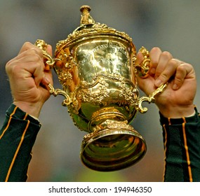 PARIS, FRANCE-OCTOBER 21, 2007:  south africa rugby player's hands holding the Web Ellis Cup, at the end of the final England vs South Africa, of the Rugby World Cup, France 2007, in Paris