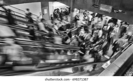 Paris, Francia. July  2017. People on the escalators in a metro station.
