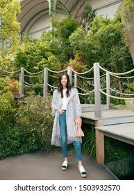 Paris, French- October 3, 2017: Famous Chinese super model liu wen is wearing Chanel black code coco watch Smiling in garden, sexy and pretty Chinese woman