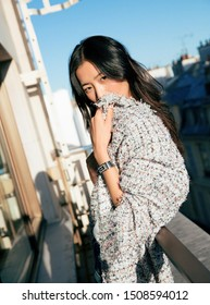 Paris, French- October 3, 2017: Famous Chinese super model liu wen is wearing Chanel black code coco watch posing On balcony, sexy and pretty Chinese woman