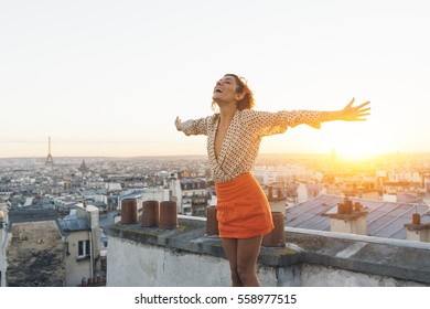 Paris, Happy woman enjoying view on the roofs of Paris