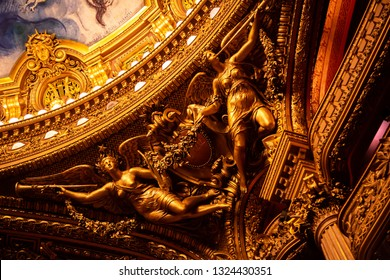 Paris, Ile de France / France - October 4 2014: Close up on the ornate gold ceiling of the Paris Opera House (Palais Garnier) with trumpeting angels