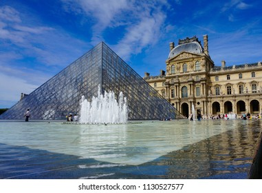 Paris, Ile de France / France - September 7 2013: View of The Louvre museum and pyramid in Paris