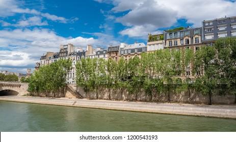 Paris, ile de la Cite and quai des Orfevres, beautiful buildings, the Pont-Neuf in background