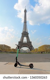 Paris, Ile-de-France/France - 04/01/2019: electric scooter in front of the Eiffel Tower in Paris