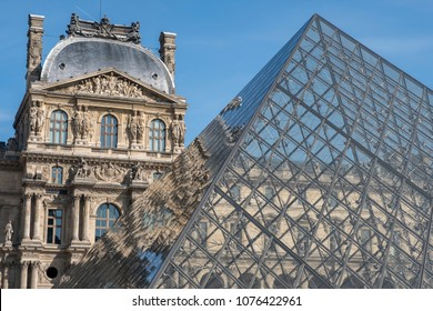 Paris, Isl de France / France - March 30 2017: Clear sky over the Louvre glass pyramid and part of the museum in the background
