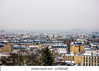 PARIS - JANUARY 19: Snowy skyline from Montmartre hill on January 19, 2013 in Paris. Snowfall is rare, but beautiful event in the city.