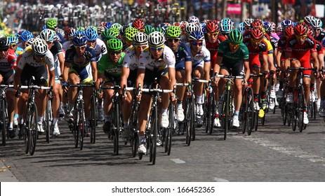 "PARIS, JUL 24: The peloton riding during the final stage of the ""Tour de France 2011"" on Avenue des Champs Elysees on 24 July 2011 in Paris, France."