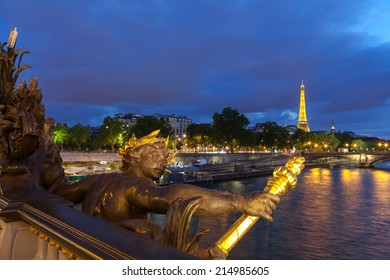 PARIS - JULY 13: The Eiffel Tower, viewed from Pont Alexandre lll, in Paris, France, on July 13,2014. The tower is illuminated at night by 20,000 lights.