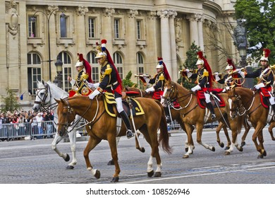 PARIS - JULY 14: Cavalry at a military parade (Defile) in the Republic Day (Bastille Day) on the Champs Elysees in Paris, France on July 14, 2012