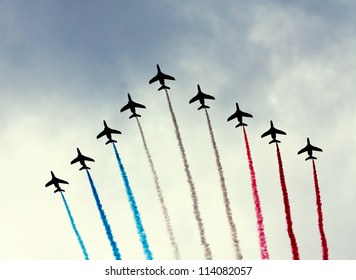 PARIS - JULY 14: French Patrouille de France at a military parade in the Republic Day (Bastille Day) on the Champs Elysees in Paris, France on July 14, 2012.