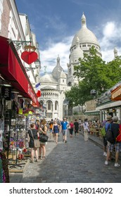 PARIS - JULY 2: The charming streets of Montmartre hill, July 2, 2012 in Paris. The quarter is full of art galleries, cafes and shops to walk about. It's one of the most visited landmarks in Paris