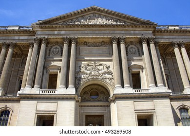 PARIS - JULY, 2016: Bottom view of a part of Louvre Museum building on a sunny day in Paris. It is the world's largest on July 9, 2016.