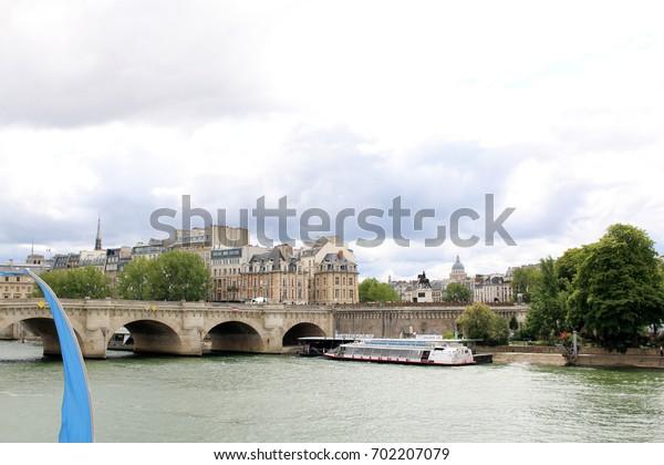 Paris, July 2017: View of seine river along Paris, France. Summer time