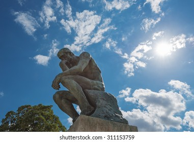 PARIS - JULY 25: view of famous statue of Rodin's The Thinker on sunny day on July 25, 2015 in Paris, France.The Thinker is a world famous bronze sculpture made by Auguste Rodin in year 1880.