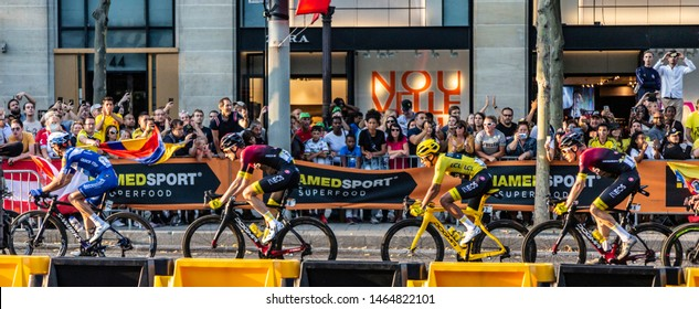 Paris - July 28, 2019: The Colombian cyclist Egan Bernal of Team Ineos, in Yellow Jersey, is riding on Avenue des Champs Elysees, during the last stage of Le Tour de France 2019.