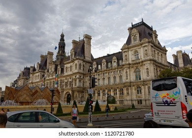 Paris - July 31, 2017: Traffic and pedestrians in front of Hotel de Ville in Paris.