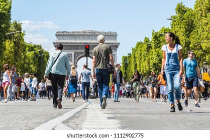 Paris- July 6,2017: People walking on the famous French boulevard Champs Elysees closed for car traffic.