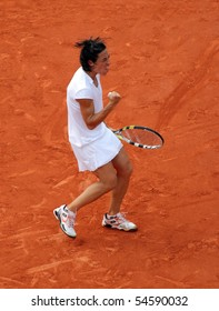 PARIS - JUNE 05: Francesca SCHIAVONE of Italy reacts after winning a decisive point during the women's singles final match of the French Open at Roland Garros on June 5, 2010 in Paris, France.