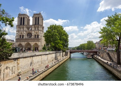 PARIS - JUNE 19, 2015: View on the Notre Dame Cathedral along the Seine in the heart of Paris.