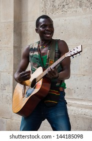 PARIS - JUNE 23: Street musician play reggae as seen on June 23, 2013 in Paris, France. Dozens buskers perform on the streets and in metro of Paris.