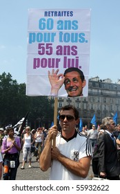 PARIS - JUNE 24: A man holding the poster '60 years for all and 55 for him' during France's nationwide strike against pension overhaul on June 24, 2010 in Paris, France.