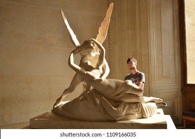 Paris - June 25: Cupid statue on June 25, 2017 in Paris. Antonio Canova's statue Psyche Revived by Cupid's Kiss, first commissioned in 1787, exemplifies the Neoclassical devotion to love and emotion.