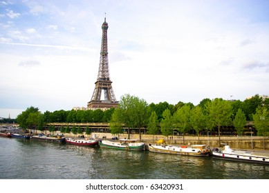 PARIS - JUNE 27 : Eiffel tower with seine river on June, 2009 in Paris, France. Eiffel tower  is an 1889 iron lattice tower located on the Champ de Mars in Paris