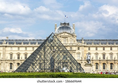 PARIS - JUNE 27: Louvre museum summer June 27, 2013 in Paris, France. Louvre Museum is one of the world's largest museums, every year museum visits more than 8 million visitors.