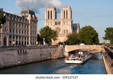 PARIS - JUNE 30: Tourists enjoy a boat trip on Seine river near Notre Dame cathedral on June 30, 2012 in Paris, France.