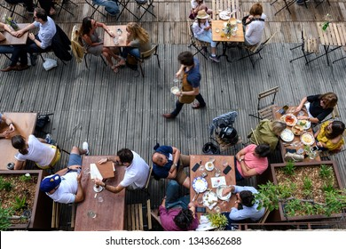 Paris, June 5, 2017 : people is havin lunch in a terrace restaurant, relaxing and friendly moment, style of life.