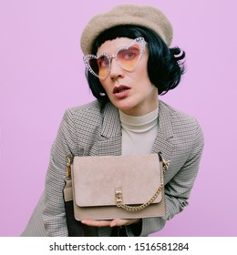 Paris lady chic. Vintage look. Beret, glasses and checkered suit