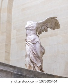 Paris, Louvre Museum. Close up of the Victory of Samothrace - Nike of Samothrace: marble sculpture of the Greek goddess of Victory, resembling a winged woman, exposed at Denon hall at Louvre. Feb 2018