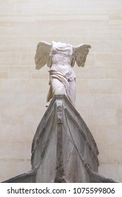 Paris, Louvre Museum. The Victory of Samothrace - Nike of Samothrace: marble sculpture of the Greek goddess of Victory, resembling a winged woman, exposed at Denon hall at Louvre Museum Paris Feb 2018