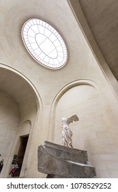 Paris, Louvre Museum. The Victory of Samothrace - Nike of Samothrace: marble sculpture of the Greek goddess of Victory resembling a winged woman, exposed at Denon hall at Louvre Museum Paris. Feb 2018