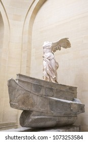 Paris, Louvre. The Victory of Samothrace - Nike of Samothrace: marble sculpture of the Greek goddess of Victory, resembling a winged woman, exposed at Denon hall at Louvre Museum Paris. February 2018