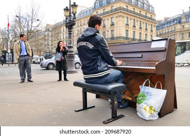 PARIS - MAR 1: A talented homeless musician plays the piano in the street to earn some money on March 1, 2014 in Paris, France.