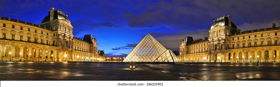 PARIS - MAR 2: External night panoramic view of the Louvre Museum (Musee du Louvre) on March 2, 2014 in Paris, France. Panoramic picture done from six pictures.